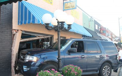 Vehicle crashes into downtown business